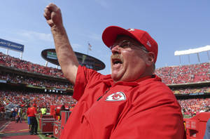 Photo - Kansas City Chiefs coach Andy Reid pumps his fist to the crowd following an NFL football game against the Dallas Cowboys at Arrowhead Stadium in Kansas City, Mo., Sunday, Sept. 15, 2013. The Chiefs won 17-16. (AP Photo/Ed Zurga)