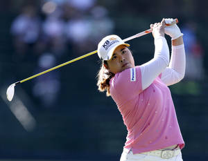 Photo - Inbee Park, of South Korea, watches her tee shot on the 13th hole during the first round of the U.S. Women's Open golf tournament in Pinehurst, N.C., Thursday, June 19, 2014. (AP Photo/Bob Leverone)