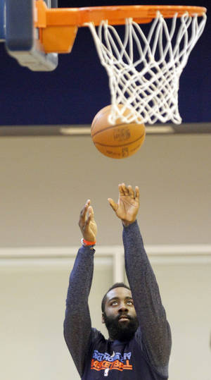 Photo - Oklahoma City's James Harden takes a shot during the Thunder's practice in Oklahoma City, Sunday, Dec. 11, 2011. Photo by Sarah Phipps, The Oklahoman