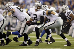 Photo - Oakland Raiders quarterback Terrelle Pryor drops back before running during the first half of an NFL football game against the Indianapolis Colts in Indianapolis, Sunday, Sept. 8, 2013. (AP Photo/Michael Conroy)