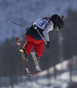 Photo - Keri Herman of the United States takes a jump during ski slopestyle training at the Rosa Khutor Extreme Park ahead of the 2014 Winter Olympics, Friday, Feb. 7, 2014, in Krasnaya Polyana, Russia. (AP Photo/Sergei Grits)