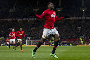 Photo - Manchester United's Danny Welbeck celebrates after scoring against Swansea City during their English Premier League soccer match at Old Trafford Stadium, Manchester, England, Saturday Jan. 11, 2014. (AP Photo/Jon Super)