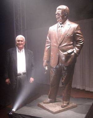 Photo - LEE ALLAN SMITH DAY....Lee Allan Smith poses with his statue by Mike  Wimmer which will be placed at the Gaylord -Pickens Museum of the  Oklahoma Heritage Center. (Photo by Helen Ford Wallace).