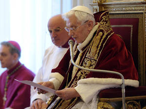 Photo - In this photo provided by the Vatican newspaper L'Osservatore Romano, Pope Benedict XVI reads a document in Latin where he announces his resignation, during a meeting of Vatican cardinals, at the Vatican, Monday, Feb. 11, 2013. Benedict XVI announced Monday that he would resign Feb. 28 - the first pontiff to do so in nearly 600 years. The decision sets the stage for a conclave to elect a new pope before the end of March. (AP Photo/L'Osservatore Romano, ho)