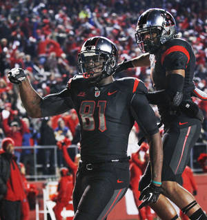 photo - Rutgers wide receiver Mark Harrison (81) celebrates his touchdown with teammate Quron Pratt during the first half of an NCAA college football game against Louisville in Piscataway, N.J., Thursday, Nov. 29, 2012. (AP Photo/Mel Evans)
