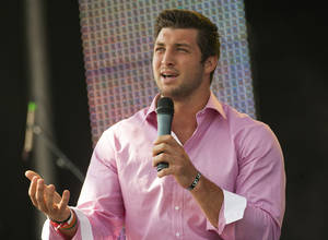 photo -   New York Jets quarterback Tim Tebow speaks at the Easter service of Celebration Church in Georgetown, Texas, Sunday, April 8, 2012. (AP Photo/William Philpott)