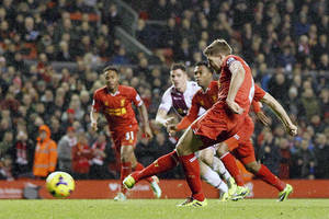 Photo - Liverpool's Steven Gerrard scores their second goal of the game from the penalty spot, during their English Premier League soccer match against Aston Villa at Anfield, Liverpool, England, Saturday, Jan. 18, 2014. (AP Photo/Peter Byrne, PA Wire)   UNITED KINGDOM OUT  -  NO SALES  -  NO ARCHIVES