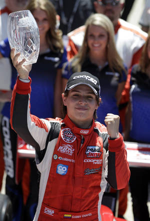 Photo - Gabby Chaves, of Colombia, celebrates after winning the Indy Lights Freedom 100 auto race at the Indianapolis Motor Speedway in Indianapolis, Friday, May 23, 2014. (AP Photo/Darron Cummings)
