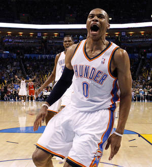 Photo - Oklahoma City's Russell Westbrook (0) and Oklahoma City's Kevin Durant (35) react during the NBA basketball game between the Oklahoma City Thunder and the Milwaukee Bucks at the Oklahoma City Arena, Wednesday, April 13, 2011. Photo by Bryan Terry, The Oklahoman