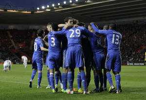 Photo - Chelsea's players celebrate Demba Ba's goal against Southampton during their English FA Cup third round soccer match at St Mary's stadium, Southampton, England, Saturday, Jan. 5, 2013. (AP Photo/Sang Tan)