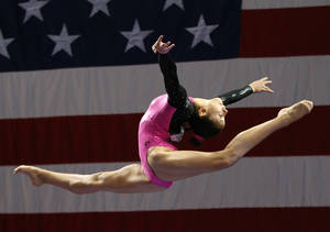 Photo - Kyla Ross competes on the balance beam during the U.S. women's national gymnastics championships in Hartford, Conn. Thursday, Aug. 15, 2013. (AP Photo/Elise Amendola)