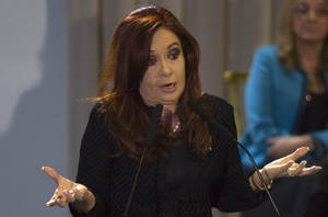 Photo -   Argentina's President Cristina Fernandez gestures as she announces a new housing-credit program in Buenos Aires, Argentina, Tuesday, June 12, 2012. (AP Photo/Eduardo Di Baia)