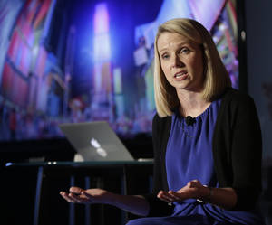 Photo - FILE - In this  Monday, May 20, 2013, file photo, Yahoo CEO Marissa Mayer speaks during a news conference in New York. Not much had been going right for Yahoo until it lured Marissa Mayer away from Google to become its CEO last summer. The move is shaping up as the best thing to happen to Yahoo since 2005 when it invested $1 billion in Alibaba, a then little-known Internet company in China. (AP Photo/Frank Franklin II)