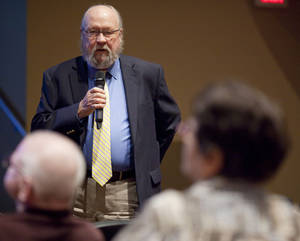 Photo -      Dr. George Kimball addresses concerned teachers and parents at a town hall meeting on Monday at NW Classen High School Hudson Performance Hall. Photo by KT King, The Oklahoman  <strong>KT King -  The Oklahoman </strong>