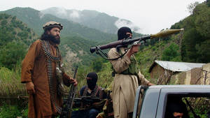 "Photo - FILE - In this file photo taken on Aug. 5, 2012, Pakistani Taliban patrol in their stronghold of Shawal in Pakistani tribal region of South Waziristan. The Pakistani army said it has launched a ""comprehensive operation"" against foreign and local militants in a tribal region near the Afghan border. An army statement issued Sunday, June 15, 2014 said the long-awaited offensive in North Waziristan was started at the direction of the government of Pakistan. (AP Photo/Ishtiaq Mahsud, File)"