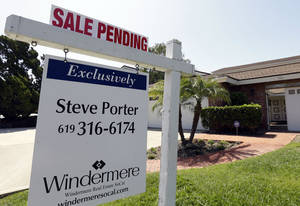 Photo - FILE - This Wednesday, Aug. 14, 2013, photo, shows a home with a sale pendingin San Diego. The National Association of Realtors reports on the number of Americans who signed contracts to buy homes in August on Thursday, Sept. 26, 2013. AP Photo/Gregory Bull, File)