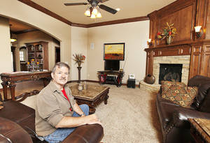 Photo - Stan Malaske of SWM & Sons Custom Homes is shown in the living room of 12005 Tuscany Ridge, a model home in Midwest City that is in the Parade of Homes Spring Festival.