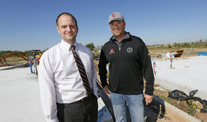 Photo - Steve Shoemaker, left, vice president of sales and marketing for Ideal Homes, and Duane Sanders, senior builder for Ideal Homes, stand near the slabs of 15212 Stillwind, left, and 15208 Stillwind in south Oklahoma City. <strong>Nate Billings - The Oklahoman</strong>