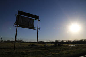 Photo - The sun sets near the old high school baseball scoreboard where former pro baseball player Scott Podsednik played in high school, Tuesday, Jan. 14, 2014 in, West, Texas. Podsednik, a West native, was part of a Texas Rangers caravan traveling through central Texas. West was devastated by a deadly fertilizer plant explosion last year. The Rangers have donated $50,000 to help renovate a park across from the plant site with a new playground and a memorial to the 15 people killed in the explosion. (AP Photo/Waco Tribune Herald, Rod Aydelotte)