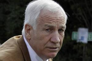 photo - Former Penn State University assistant football coach Jerry Sandusky arrives at the Centre County Courthouse in Bellefonte, Pa., Friday, June 22, 2012. Sandusky is accused of sexual abuse of 10 boys over a 15-year period. (AP Photo/Gene J. Puskar)