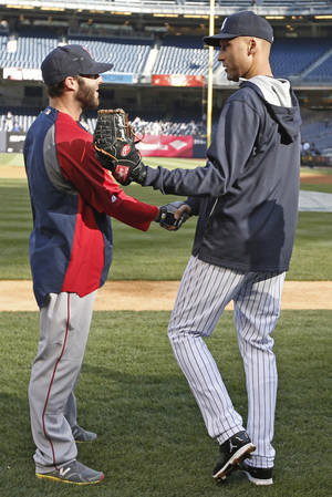 Photo - New York Yankees shortstop Derek Jeter, right, greets Boston Red Sox second baseman Dustin Pedroia before a baseball game at Yankee Stadium in New York, Thursday, April 10, 2014.  (AP Photo/Kathy Willens)