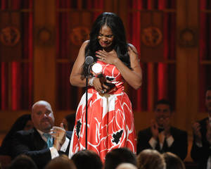 "Photo - Audra McDonald accepts the award for best performance by an actress in a leading role in a play for ""Lady Day at Emerson's Bar & Grill"" on stage at the 68th annual Tony Awards at Radio City Music Hall on Sunday, June 8, 2014, in New York. (Photo by Evan Agostini/Invision/AP)"