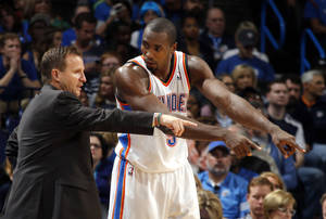 Photo - Oklahoma City's Serge Ibaka (9) talks with Oklahoma City coach Scott Brooks during the NBA game between the Oklahoma City Thunder and the Washington Wizards at the Chesapeake Energy Arena, Sunday, Nov. 10, 2013. Photo by Sarah Phipps, The Oklahoman