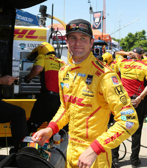 Photo - Indianapolis 500 winner  Ryan Hunter-Reay is seen in the pit area after a practice session for the IndyCar Detroit Grand Prix auto race on Belle Isle in Detroit, Friday, May 30, 2014. (AP Photo/Bob Brodbeck)