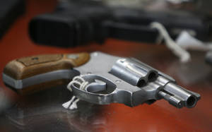 photo - FILE - In this June 26, 2008 file photo, a chrome plated revolver rests on top of a glass display case at John Jovino Co. in New York. A New York county clerk on Thursday, Jan. 3, 2013 justified his refusal to release the names and addresses of handgun permit holders to a newspaper, saying it would give stalkers and thieves a convenient roadmap to target potential victims — and determine whether they have a gun. (AP Photo/Seth Wenig, File)
