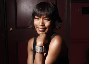 "Photo - FILE - This Jan. 12, 2012 file photo shows actress Angela Bassett at Sardi's restaurant in New York. Bassett co-stars in the action flick, ""Olympus Has Fallen.""   (AP Photo/Carlo Allegri, file)"