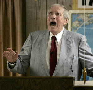 Photo - FILE - In this March 19, 2006 file photo, the Rev. Fred Phelps Sr. preaches at his Westboro Baptist Church in Topeka, Kan. Phelps, the founder of the Kansas church known for anti-gay protests and pickets at military funerals, died late Wednesday, March 19, 2014, his family said. He was 84. (AP Photo/Charlie Riedel, File)