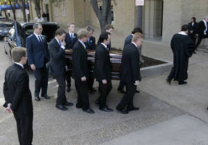Photo - Pallbearers carry Van Cliburn's coffin into Broadway Baptist Church for a funeral service for in Fort Worth, Texas on Sunday, March 3, 2013. The internationally famous musician died this week. About 1,400 people attended a memorial service for Cliburn, who died Wednesday at 78 after fighting bone cancer. As the service began, the Fort Worth Symphony Orchestra accompanied a choir as pall bearers carried his flower-covered coffin into the Fort Worth church. (AP Photo/Star-Telegram, Ron T. Ennis, Pool)