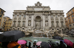"Photo - Tourists gather at Trevi's fountain, in Rome, Monday, Jan. 28, 2013. The Fendi fashion house is financing an euro 2.12 million ($2.8 million) restoration of Trevi Fountain in Rome, famed as a setting for the film ""La Dolce Vita'' and the place where dreamers leave their coins. The 20-month project on one of the city's most iconic fountains was being unveiled at a city hall press conference Monday. (AP Photo/Gregorio Borgia)"