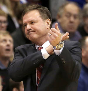 Photo - Kansas coach Bill Self reacts to a missed basket during the second half of an NCAA college basketball game against San Diego State, Sunday, Jan. 5, 2014, in Lawrence, Kan. San Diego State won 61-57.(AP Photo/Charlie Riedel)