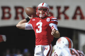 Photo -   Nebraska quarterback Taylor Martinez (3) throws in the first half of an NCAA college football game against Idaho State, in Lincoln, Neb., Saturday, Sept. 22, 2012. (AP Photo/Dave Weaver)