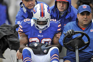 Photo -   Buffalo Bills running back C.J. Spiller (28) is taken to the locker room after injuring his shoulder in the first quarter of an NFL football game against the Cleveland Browns, Sunday, Sept. 23, 2012, in Cleveland. (AP Photo/David Richard)
