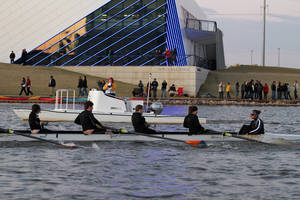 photo - Members of the Putnam City High School crew row past the Devon Boathouse during last year's OKC Riversport Youth League Championship on the Oklahoma River. OKLAHOMAN archive photo