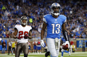 Photo - Detroit Lions wide receiver Nate Burleson (13) beats Tampa Bay Buccaneers defensive back Rashaan Melvin (28) for a 5-yard touchdown reception during the second quarter of an NFL football game at Ford Field in Detroit, Sunday, Nov. 24, 2013. (AP Photo/Rick Osentoski)