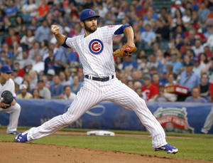 Photo - Chicago Cubs starting pitcher Jake Arrieta delivers during the first inning of a baseball game against the Cincinnati Reds on Tuesday, June 24, 2014, in Chicago. (AP Photo/Charles Rex Arbogast)