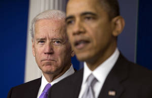 photo - Vice President Joe Biden, left, listens as President Barack Obama announces that Biden will lead an administration-wide effort to curb gun violence in response to the Connecticut school shooting, during a news conference in the briefing room of the White House on Wednesday, Dec. 19, 2012 in Washington.  (AP Photo/ Evan Vucci)