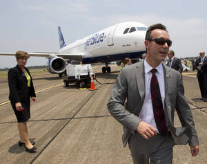 Photo - Airbus President & CEO Fabrice Bregier walks away from a JetBlue Airbus A320 aircraft at Brookley Field after announcing that Airbus will establish its first assembly plant in the United States in Mobile, Ala., Monday, July 2, 2012. The French-based company said the Alabama plant is expected to cost $600 million to build and will employ 1,000 people when it reaches full production, likely to be four planes a month by 2017. (AP Photo/Dave Martin) ORG XMIT: ALDM115