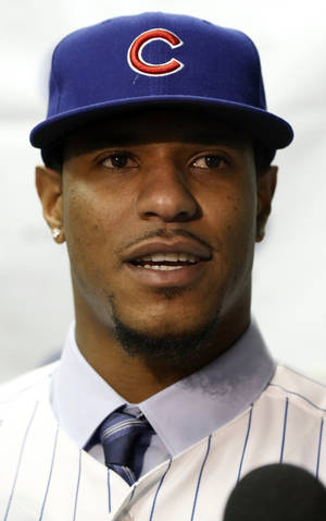 photo - Pitcher Edwin Jackson talks with reporters after signing a four-year, $52 million contract with the Chicago Cubs during a baseball news conference at Wrigley Field, Wednesday, Jan. 2, 2013, in Chicago. (AP Photo/Charles Rex Arbogast)