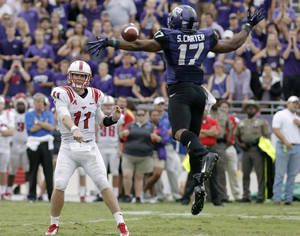 Photo - TCU safety Sam Carter (17) is unable to block SMU quarterback Garrett Gilbert's (11) touchdonw pass to wide receiver Darius Joseph (18) during the second half of an NCAA college football game Saturday, Sept. 28, 2013, in Fort Worth, Texas. TCU won 48-17.(AP Photo/Brandon Wade)