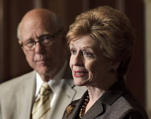 photo -   FILE - In this June 6, 2012 file photo, Sen. Pat Roberts, R-Kansas, ranking Republican on the Senate Agriculture Committee, listens at left as Committee Chair Sen. Debbie Stabenow, D-Mich. speaks about the farm bill during a news conference on Capitol Hill in Washington. (AP Photo/J. Scott Applewhite)