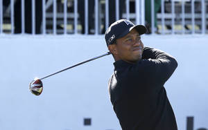 Photo - Tiger Woods watches his tee shot on the first hole during the final round of the BMW Championship golf tournament at Conway Farms Golf Club in Lake Forest, Ill., Monday, Sept. 16, 2013. (AP Photo/Charles Rex Arbogast)