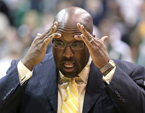 Photo -   FILE - In this Nov. 7, 2012 file photo Los Angeles Lakers head coach Mike Brown holds his head before the start of the first quarter during an NBA basketball game in Salt Lake City. A report from USA Today says the Lakers have fired Brown after a 1-4 start to his second season in charge of the team. The newspaper report Friday, Nov. 9, 2012 cited Brown's agent, Warren Legarie, as the source of the information. (AP Photo/Rick Bowmer, File)