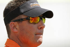 Photo - COLLEGE FOOTBALL: OSU head coach Mike Gundy watches the Orange/White spring football game for the Oklahoma State University Cowboys at Boone Pickens Stadium in Stillwater, Okla., Saturday, April 16, 2011. Photo by Nate Billings, The Oklahoman ORG XMIT: KOD