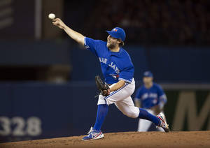 Photo - Toronto Blue Jays starting pitcher R.A. Dickey delivers a pitch during the fourth inning of a baseball game against the New York Yankees in Toronto on Saturday, April 5, 2014. (AP Photo/The Canadian Press, Peter Power)