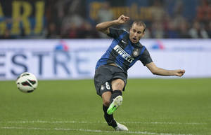 Photo -   Inter Milan forward Rodrigo Palacio, of Argentina, scores a goal during an Europa League play-off second leg soccer match between Inter Milan and Vaslui, at the San Siro stadium in Milan, Italy, Thursday, Aug. 30, 2012. (AP Photo/Emilio Andreoli)