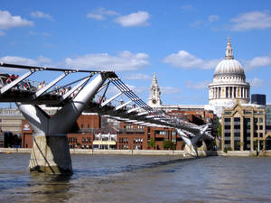 Photo - The pedestrian-only Millennium Bridge leads over the Thames to Christopher Wren's masterpiece, St. Paul's Cathedral, which he labored over for more than 40 years. (credit: Cameron Hewitt)